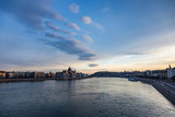 view of parliament and danube at sunset in budapest