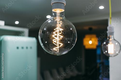 Foto Murales Light decoration bulb filaments on a lounge interior
