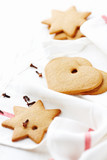 Gingerbread cookies. Christmas time. White background. Copy space.   - 227611735