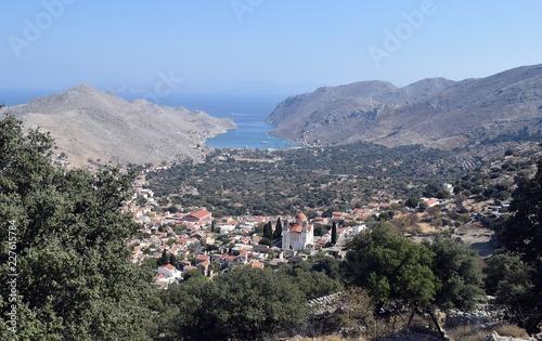 Fridge magnet   Хarbour. Sea city. Mountain village. Greek island. Greece.Simi Island.Beautiful mountain landscape.