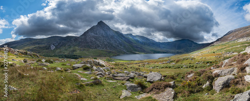 Stunning panoramic landscape image of countryside around Llyn Ogwen in Snowdonia during early Autumn with Tryfan in background