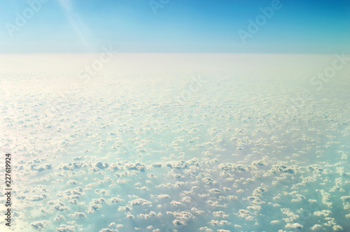 Clouds over ocean from airplane. - 227619924