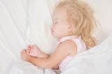 little blonde baby girl sleeping on a bed. Top view. Space for text - 227622957