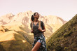 Woman hiking in mountains and looking at the scenic view