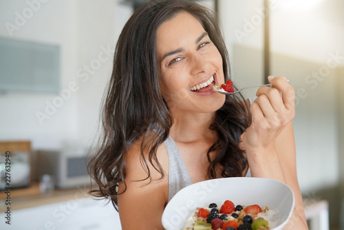 Sticker Brunette woman having healthy breakfast at home
