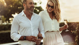 Beautiful couple with a glass of wine outdoors - 227633334