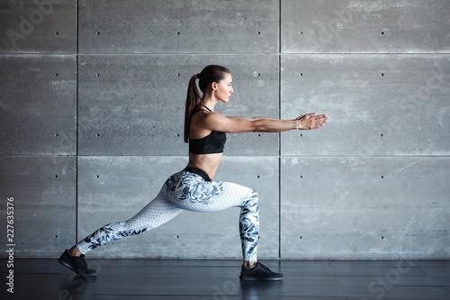 Leinwandbild Motiv Sports girl in the gym doing exercises.