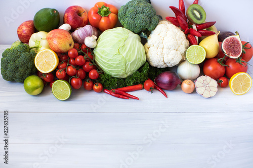 Foto Murales Collection fresh fruits and vegetables on a wooden table.