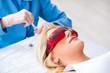 Leinwandbild Motiv Woman visiting doctor for plastic surgery