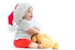 Leinwanddruck Bild - Happy baby boy with a Santa hat with a Christmas present box