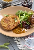 Fried pork chop with fresh herbs and fruit sauce, vertical - 227642182