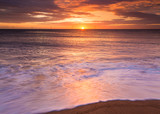 Sunrise over Seaton Sluice Beach and Harbour entrance on the coast of Northumberland, England, UK.