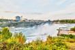 Experiencing Powerful Niagara Falls at Rainbow Bridge Connecting New York State and Ontario - 227662941