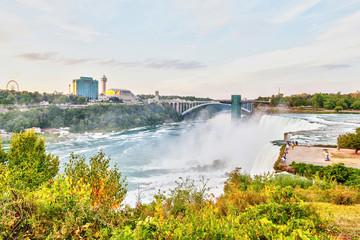 Experiencing Powerful Niagara Falls at Rainbow Bridge Connecting New York State and Ontario