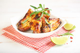 Teriyaki chicken wings. Baked chicken  with fresh rosemary. Homemade food. Symbolic image. Concept for a tasty and healty dish. Bright wooden background. Copy space. - 227664742
