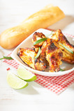 Teriyaki chicken wings. Baked chicken  with fresh rosemary. Homemade food. Symbolic image. Concept for a tasty and healty dish. Bright wooden background. Copy space. - 227666132