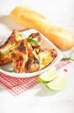 Teriyaki chicken wings. Baked chicken  with fresh rosemary. Homemade food. Symbolic image. Concept for a tasty and healty dish. Bright wooden background. Copy space. - 227666334