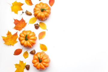 Autumn composition. Pumpkins, dried leaves on white background. Halloween concept. Flat lay, top view, copy space