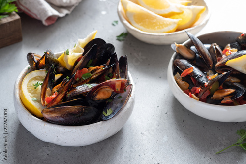 Fototapeta Seafood mussels with sauce and parsley