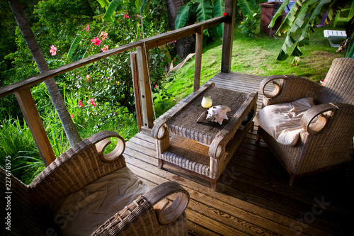 armchairs on a terrace in the jungle in the Carribean, Guadeloupe - 227678575
