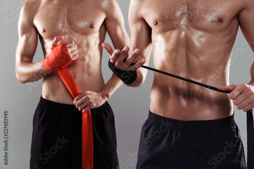 Sticker Close up of a two muscular shirtless twin brothers