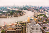 The bend in the Thames river and the London skyline on a misty late afternoon in June 2013 - 227686309