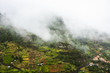 Low clouds over the mountain village. - 227687380
