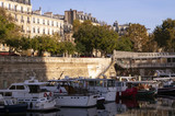 Boats parked in front of buildings in Paris on the banks of the Seine