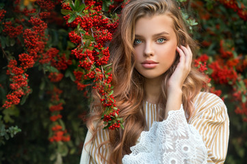 Beautiful girl walking outdoors in autumn.