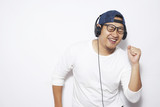 Happy Young Man Dancing while Listening Music - 227708732