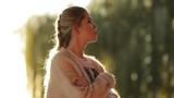 Portrait of woman in sun light, sunset evening time - 227735755