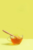 Fresh organic liquid honey on a yellow background. Close up. Copy space - 227736576
