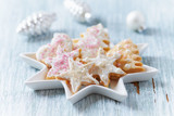 Christmas butter cookies with icing and sugar pearls. Bright wooden background. Close up. - 227743529