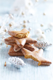 Gingerbread cookies for Christmas. Christmas background. Bright wooden background. Close up.  - 227747747