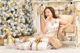Portrait of a beautiful woman sitting near chair - 227765990