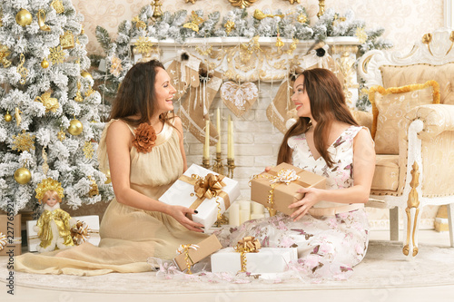 Foto Murales Portrait of beautiful young women with gifts posing
