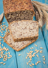 Multi-grain bread on a wooden background. Healthy food concept.