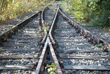 two railway tracks come together with railroad switch - 227770964
