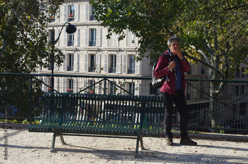 A man walks in the streets and parks of Paris - 227774977