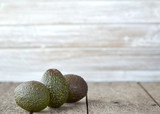 Avocado on old wooden background - 227776588