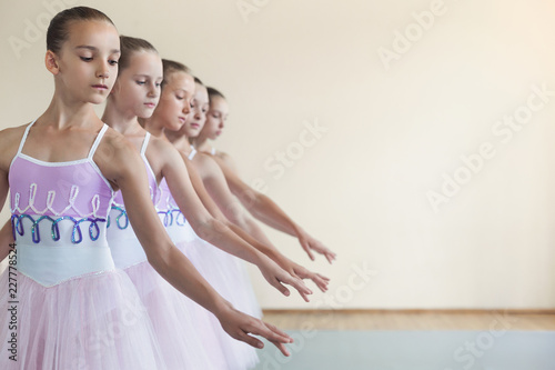 Group of young girls dancing ballet in studio © Prostock-studio