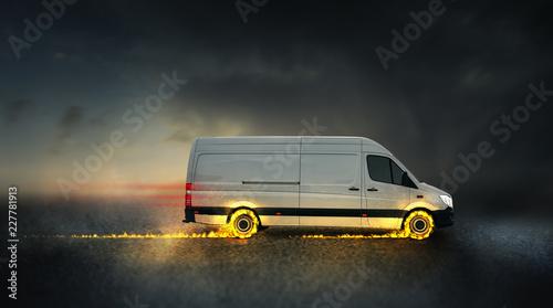 Leinwandbild Motiv schneller Lieferwagen mit brennenden Reifen