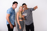 Three multi-ethnic friends together against white background - 227782394