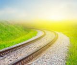 railway turn among a green fields - 227783533