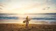 Leinwandbild Motiv  Silhouette of beautiful surfer on the beach at sunset