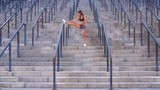 Young woman doing fitness workout and stretch exercises for health on the stadium stairs - 227803990