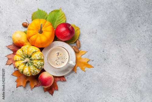 Wall mural Autumn backdrop with pumpkins and fruits