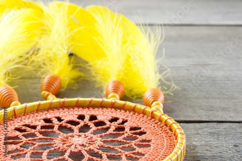 Orange yellow dream catcher on gray