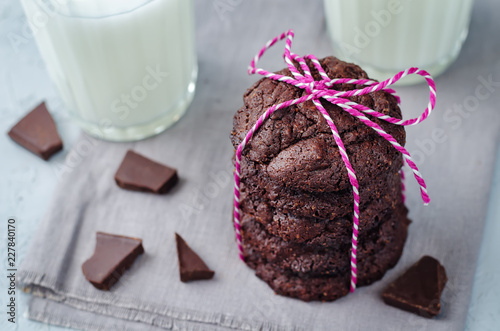 Chocolate brownie cookies with glasses of milk