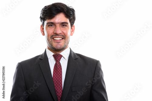 Foto Murales Studio shot of young happy Persian businessman smiling